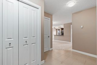 Photo 3: 7411 403 Mackenzie Way SW: Airdrie Apartment for sale : MLS®# A1152134