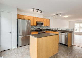 Photo 15: 311 Toscana Gardens NW in Calgary: Tuscany Row/Townhouse for sale : MLS®# A1133126