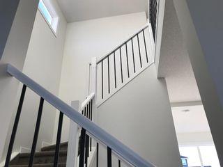 Photo 17: 11 Sundown Manor: Cochrane Semi Detached for sale : MLS®# A1071566