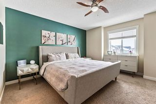 Photo 11: 1562 93 Street SW in Calgary: Aspen Woods Row/Townhouse for sale : MLS®# A1085332