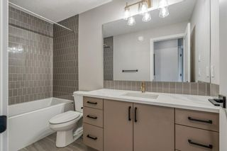 Photo 24: 309 81 Greenbriar Place NW in Calgary: Greenwood/Greenbriar Row/Townhouse for sale : MLS®# A1058995