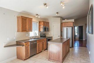 Photo 6: 102 Morris Place: Didsbury Detached for sale : MLS®# A1045288