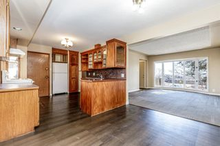 Photo 6: 5615 Thorndale Place NW in Calgary: Thorncliffe Detached for sale : MLS®# A1091089