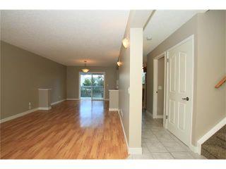 Photo 3: 74 WEST TERRACE Road: Cochrane House for sale : MLS®# C4073559