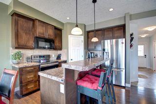 Photo 2: 130 413 River Avenue: Cochrane Row/Townhouse for sale : MLS®# A1112012