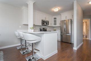 Photo 1: 209 27358 32 Avenue in Langley: Aldergrove Langley Condo for sale : MLS®# R2351170