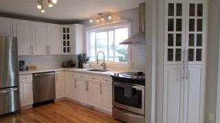 """Photo 2: 9907 114 Avenue in Fort St. John: Fort St. John - City NE House for sale in """"BERT AMBROSE"""" (Fort St. John (Zone 60))  : MLS®# R2477769"""
