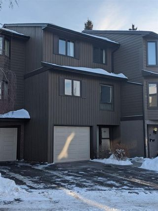 Photo 1: 100 23 Glamis Drive SW in Calgary: Glamorgan Row/Townhouse for sale : MLS®# A1056750