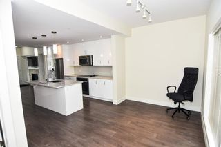 Photo 23: 207 20 Brentwood Common NW in Calgary: Brentwood Row/Townhouse for sale : MLS®# A1143237