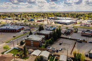 Photo 10: 1718 Henderson Lake Boulevard S: Lethbridge Multi Family for sale : MLS®# A1139951