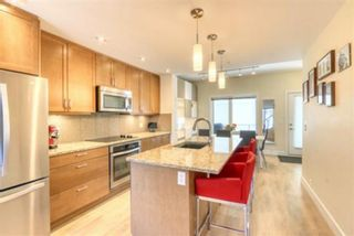 Photo 2: 206 20 Brentwood Common NW in Calgary: Brentwood Row/Townhouse for sale : MLS®# A1094821