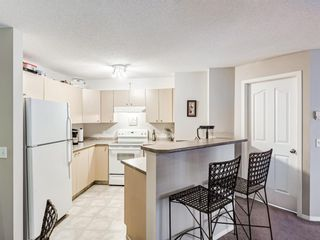 Photo 4: 8425 304 Mackenzie Way SW: Airdrie Apartment for sale : MLS®# A1085933