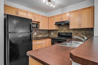 Photo 1: 8108 70 PANAMOUNT Drive NW in Calgary: Panorama Hills Apartment for sale : MLS®# C4299723