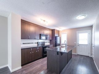 Photo 6: 70 Auburn Bay Link SE in Calgary: Auburn Bay Row/Townhouse for sale : MLS®# A1102367