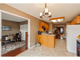 """Photo 2: 103 5641 201 Street in Langley: Langley City Townhouse for sale in """"THE HUNTINGTON"""" : MLS®# R2537246"""