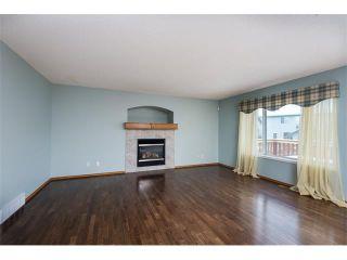 Photo 4: 223 CRYSTALRIDGE Place: Okotoks House for sale : MLS®# C4091900