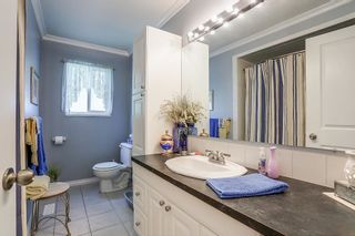 Photo 11: 8736 TULSY Crescent in Surrey: Queen Mary Park Surrey House for sale : MLS®# R2192315