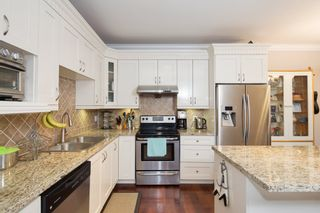 """Photo 1: 101 3333 DEWDNEY TRUNK Road in Port Moody: Port Moody Centre Townhouse for sale in """"CENTREPOINT"""" : MLS®# R2378597"""