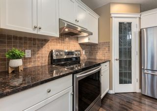 Photo 8: 735 Coopers Drive SW: Airdrie Detached for sale : MLS®# A1132442