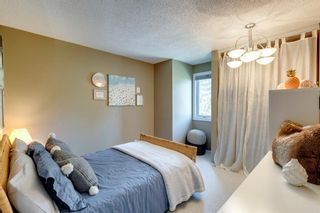 Photo 18: 81 Coachway Gardens SW in Calgary: Coach Hill Row/Townhouse for sale : MLS®# A1147900