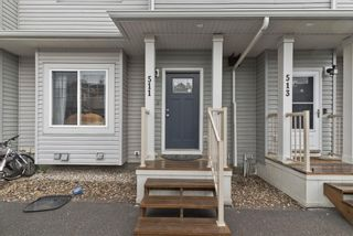 Photo 2: 511 Strathaven Mews: Strathmore Row/Townhouse for sale : MLS®# A1118719