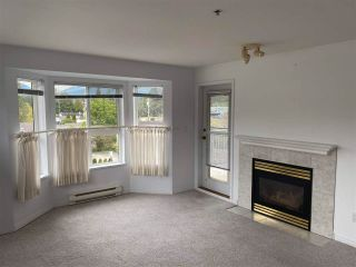 "Photo 1: 307 5711 MERMAID Street in Sechelt: Sechelt District Condo for sale in ""MERMAID PLACE"" (Sunshine Coast)  : MLS®# R2573088"