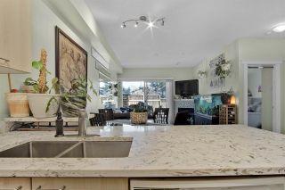 """Photo 5: 211 12083 92A Avenue in Surrey: Queen Mary Park Surrey Condo for sale in """"The Tamaron"""" : MLS®# R2557929"""