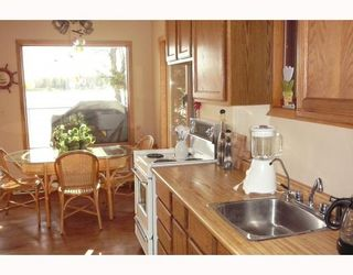 """Photo 7: 56805 BEAUMONT Road in Prince_George: Cluculz Lake House for sale in """"CLUCULZ"""" (PG Rural West (Zone 77))  : MLS®# N189147"""