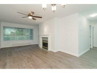"Photo 2: 203 9626 148 Street in Surrey: Guildford Condo for sale in ""Hartford Woods"" (North Surrey)  : MLS®# R2293967"