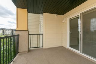 Photo 23: 8329 304 MACKENZIE Way SW: Airdrie Apartment for sale : MLS®# A1128736