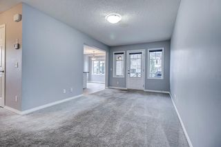 Photo 3: 129 Windstone Park SW: Airdrie Row/Townhouse for sale : MLS®# A1137155