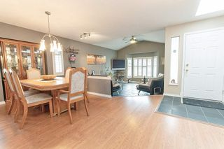 """Photo 4: 7874 143A Street in Surrey: East Newton House for sale in """"Springhill"""" : MLS®# R2554055"""