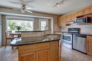 Photo 2: 91 Douglas Woods Hill SE in Calgary: Douglasdale/Glen Detached for sale : MLS®# A1017317