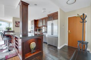 """Photo 8: 311 1450 PENNYFARTHING Drive in Vancouver: False Creek Condo for sale in """"Harbour Cove/False Creek"""" (Vancouver West)  : MLS®# R2618679"""