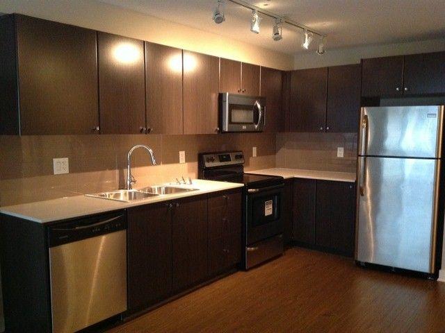 Main Photo: 214 13740 75A Avenue in Surrey: East Newton Condo for sale : MLS®# F1400632