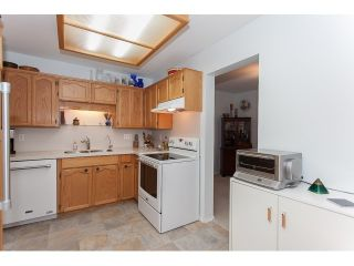 """Photo 8: 102 5375 205 Street in Langley: Langley City Condo for sale in """"GLENMONT PARK"""" : MLS®# R2053882"""