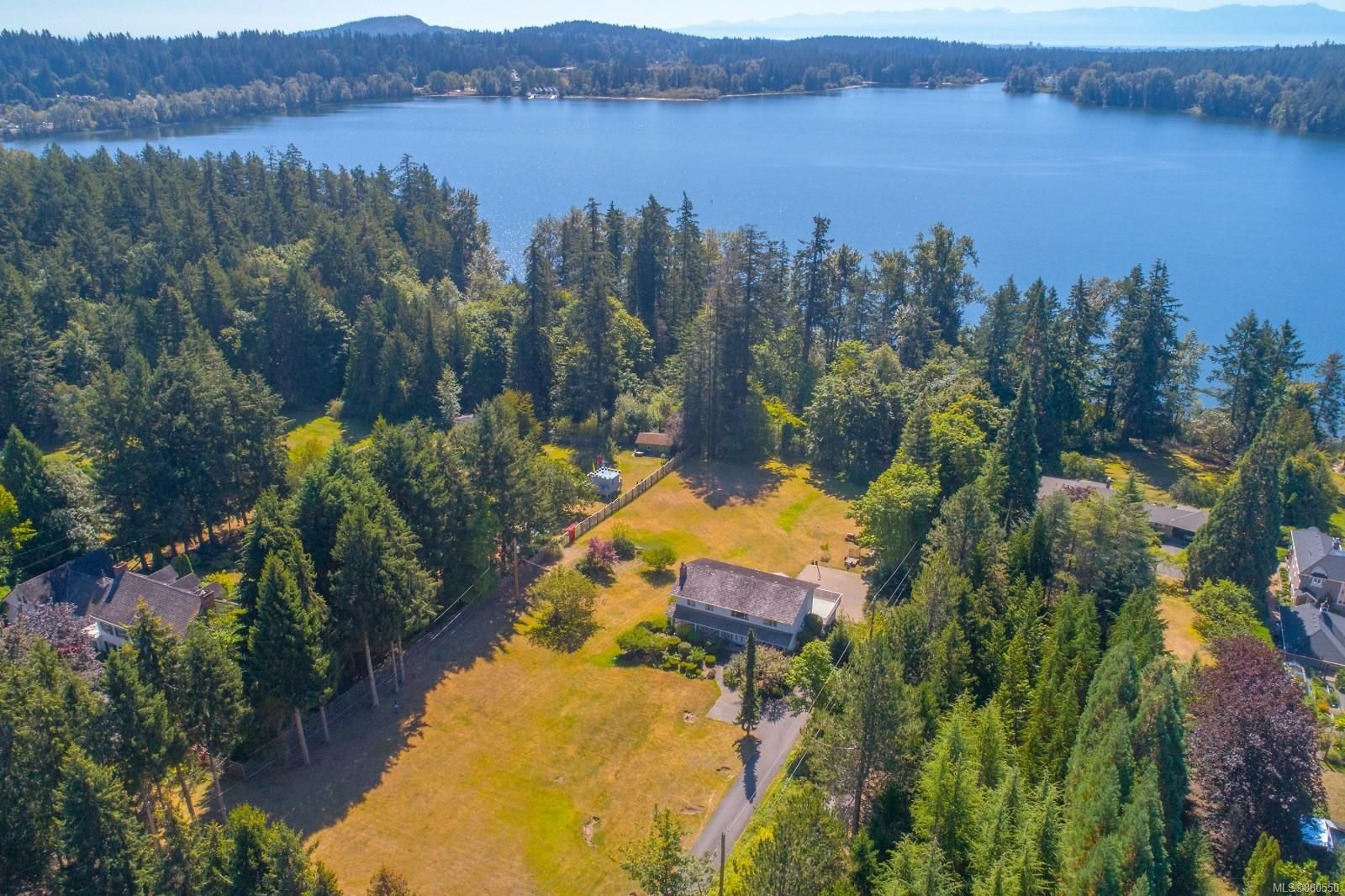 Main Photo: 585 Brookleigh Rd in : SW Elk Lake House for sale (Saanich West)  : MLS®# 860550