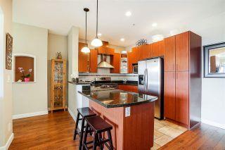 "Photo 3: 306 976 ADAIR Avenue in Coquitlam: Maillardville Condo for sale in ""Orlean's Ridge"" : MLS®# R2246999"