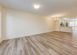 Photo 3: 402 2445 Kingsland Road SE: Airdrie Row/Townhouse for sale : MLS®# A1107683