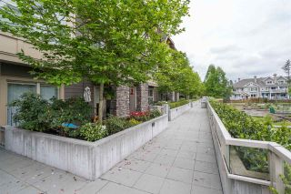 "Photo 1: 104 2110 ROWLAND Street in Port Coquitlam: Central Pt Coquitlam Townhouse for sale in ""AVIVA ON THE PARK"" : MLS®# R2168071"