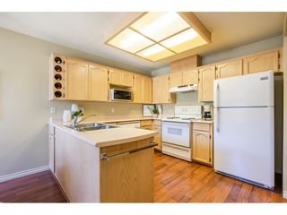 """Photo 13: 106 19649 53 Avenue in Langley: Langley City Townhouse for sale in """"Huntsfield Green"""" : MLS®# R2595915"""