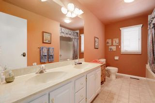 Photo 14: 32 Pump Hill Mews SW in Calgary: Pump Hill Detached for sale : MLS®# A1137956
