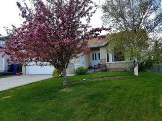 Photo 1: 77 WEST EDGE Road: Cochrane House for sale : MLS®# C4177581