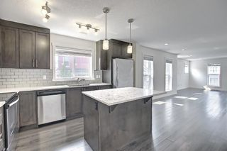 Photo 8: 216 Cranford Mews SE in Calgary: Cranston Row/Townhouse for sale : MLS®# A1134650