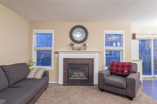 Photo 6: 1052 WINDSONG Drive SW: Airdrie Detached for sale : MLS®# C4238764