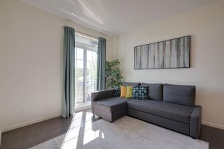 Photo 7: 111 Ascot Point SW in Calgary: Aspen Woods Row/Townhouse for sale : MLS®# A1144877