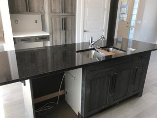 Photo 29: 23 Sunrise Heights: Cochrane Duplex for sale : MLS®# A1017998