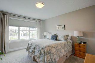 Photo 13: 340 Quarry Park Boulevard SE in Calgary: Douglasdale/Glen Row/Townhouse for sale : MLS®# A1123884