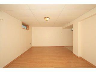 Photo 39: 74 WEST TERRACE Road: Cochrane House for sale : MLS®# C4073559