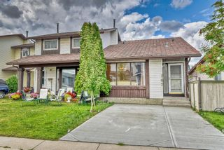Photo 1: 167 Templevale Road NE in Calgary: Temple Semi Detached for sale : MLS®# A1140728